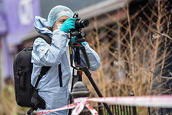 © Licensed to London News Pictures. 31/12/2018. West London, UK. Forensic photographer records the scene of what police are treating as an attempted murder. A man in his 30s was left fighting for his life after being stabbed on Fulham Palace Road in an unprovoked attack in the early hours of New Years Eve. Police have arrested 39 individuals at a party at a near by address where the assailant ran to following the attack according to eye witnesses. Photo credit Guilhem Baker/LNP