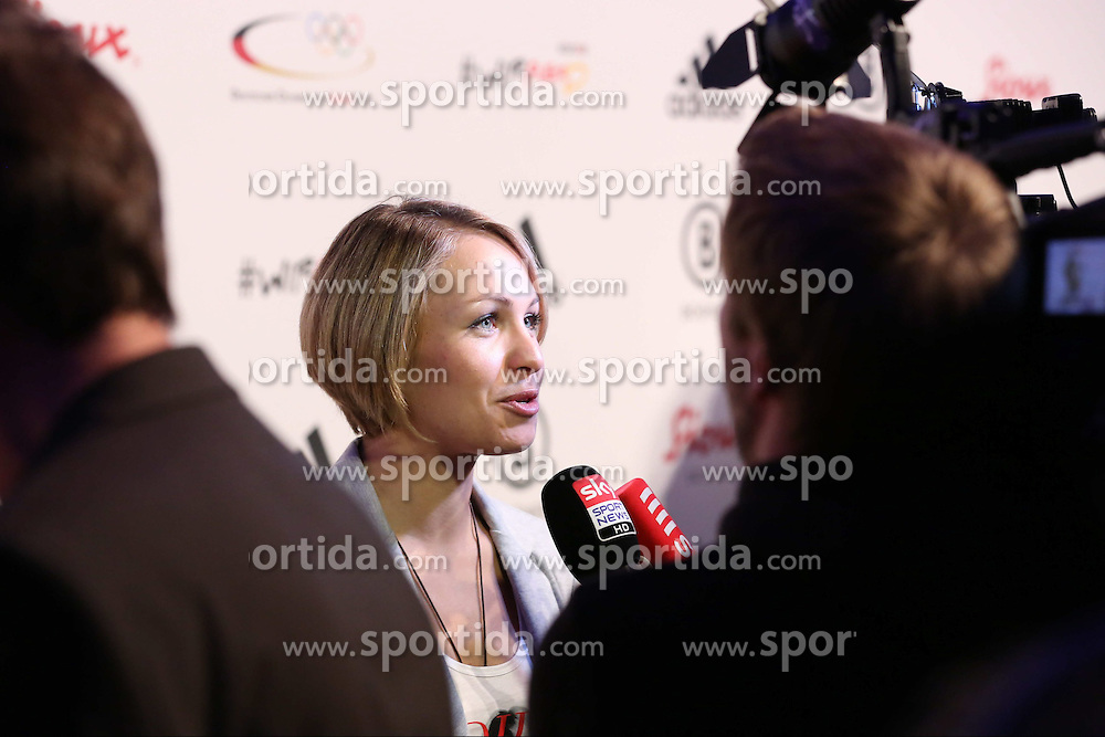 01.10.2013, Messe, Duesseldorf, GER, Einkleidung Olympiamannschaft Sochi 2014, im Bild Magdalena Neuner gibt freudig Fernseh Interviews, // during the Presentation of the Olympic Team Germany for Sochi 2014 at the Messe, Duesseldorf, Germany on 2013/10/01. EXPA Pictures &copy; 2013, PhotoCredit: EXPA/ Eibner/ Joerg Schueler<br /> <br /> ***** ATTENTION - OUT OF GER *****