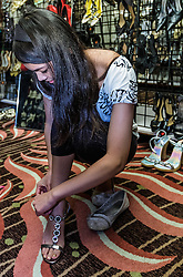 IRVINE, CA - MARCH 2:  Dream Girls try on shoes, dresses and accessories during the Working Wardrobes Dream Girls & Distinguished Gentlemen 2013 event at the Irvine Hilton in Irvine, CA. Working Wardrobes (http://www.workingwardrobes.org) is a non-profit organization located in Costa Mesa, CA. PHOTO: © 2013 SILVEX.PHOTOSHELTER.COM.