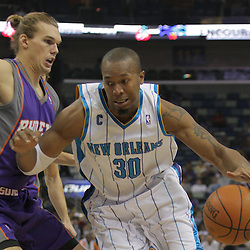 Nov 19, 2009; New Orleans, LA, USA; New Orleans Hornets forward David West (30) drives past Phoenix Suns forward Louis Amundson (17) during the send quarter at the New Orleans Arena. Mandatory Credit: Derick E. Hingle-US PRESSWIRE