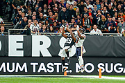 Anthony Miller (WR) of the Chicago Bears catches the ball under pressure from Lamarcus Joyner (S) of the Oakland Raiders during the International Series match between Oakland Raiders and Chicago Bears at Tottenham Hotspur Stadium, London, United Kingdom on 6 October 2019.
