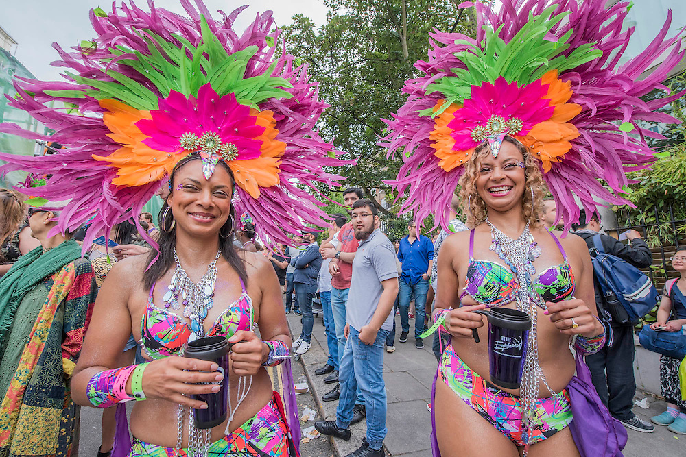 Drinking rum cocktails from cooler mugs - Crowds flock to see the 50th Notting hill carnival on Bank Holiday Monday.