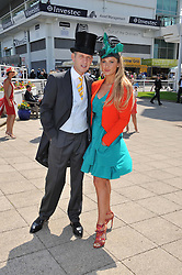 JEREMY KYLE and his wife CARLA at the Investec Derby at Epsom Racecourse, Epsom Downs, Surrey on 4th June 2011.