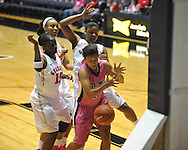 """Ole Miss' Diara Moore (10) vs. Georgia's Shacobia Barbee (20), Jasmine Hassell (12), and Krista Donald (12) in women's basketball at the C.M. """"Tad"""" Smith Coliseum in Oxford, Miss. on Sunday, February 24, 2013. Georgia won 73-54."""