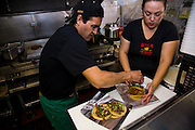 Lourdes Alvarez prepares tacos at her Mexican Restaurant, El Coyote, in the suburb of Alsip, Chicago. (Lourdes Alvarez is featured in the book What I Eat;  Around the World in 80 Diets.)   MODEL RELEASED.