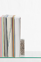 Paper stationery on glass shelf studio shot