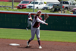 22 April 2017:  Madison Jones blocks 2nd and throws to first trying to force a rundown during a Missouri Valley Conference (MVC) women's softball game between the Missouri State Bears and the Illinois State Redbirds on Marian Kneer Field in Normal IL