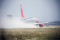 © Licensed to London News Pictures. 17/03/2018. Leeds UK. A Jet 2 aircraft prepares for take off in the snow at Leeds Bradford airport this morning as the Beast from the East 2 start's to batter Britain. Photo credit: Andrew McCaren/LNP