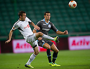 (L) Legia's Miroslav Radovic fights for the ball during the UEFA Europa League Group J football match between Legia Warsaw and Apollon Limassol FC at Pepsi Arena Stadium in Warsaw on October 03, 2013.<br /> <br /> Poland, Warsaw, October 03, 2013<br /> <br /> Picture also available in RAW (NEF) or TIFF format on special request.<br /> <br /> For editorial use only. Any commercial or promotional use requires permission.<br /> <br /> Mandatory credit:<br /> Photo by &copy; Adam Nurkiewicz / Mediasport