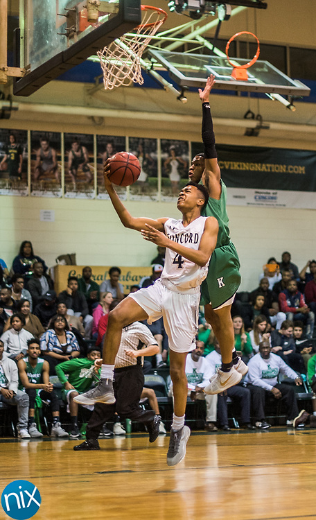 Concord's Jordan Stowe (4) goes up for a shot against Kannapolis during a South Piedmont Conference basketball game Saturday night at Central Cabarrus High School.
