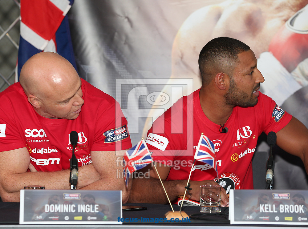 Dominic Ingle (left) and Kell Brook exchange words with Errol Spence at the press conference, in anticipation of the Brook v Spence contest, at Bramall Lane, Sheffield<br /> Picture by James Wilson/Focus Images Ltd 07709 548263<br /> 22/03/2017