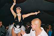 Man with shaved head and necklace ogling a girl wearing a 'sexy maid' outfit on the dancefloor, Posh at Addington Palace, UK, August, 2004