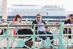 © Licensed to London News Pictures. 278/09/2015. Brighton, UK. Visitors for the labour Party conference relax and have an ice cream during lunch. Today September 28th 2015. Photo credit : Hugo Michiels/LNP