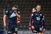 31st October 2018, Kilmac Stadium, Dundee, Scotland; Ladbrokes Premiership football, Dundee v Celtic; Andy Boyle and Kenny Miller of Dundee at the end
