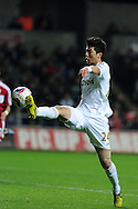 Swansea city's Ki Sung-Yueng in action. Capital one cup, quarter final, Swansea city v Middlesbrough at the Liberty Stadium in Swansea, South Wales on Wednesday 12th Dec 2012. pic by Andrew Orchard, Andrew Orchard sports photography,