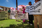 "31 JULY 2012 - PHOENIX, AZ:  MEDEA BENJAMIN, center, speaks at a press conference at the Arizona State Capitol Tuesday. Medea is a political activist, best known for co-founding Code Pink and, along with her husband, activist and author Kevin Danaher, the fair trade advocacy group Global Exchange. She was also a Green Party candidate in 2000 for the United States Senate. She appeared in Phoenix to promote her new book, ""Drone Warfare: Killing by Remote Control."" She, and other members of Code Pink, presented a letter to Arizona Gov. Jan Brewer protesting Brewer's request to use the state's airspace to train drone pilots.  PHOTO BY JACK KURTZ"