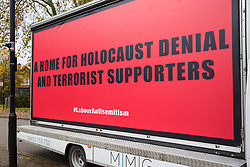 London, UK. 26 November, 2019. A hoarding bearing the words 'A Home for Holocaust Denial and Terrorist Supporters' parked outside the Bernie Grant Arts Centre in Tottenham before the arrival of Labour Party leader Jeremy Corbyn to launch Labour's new Race and Faith Manifesto.