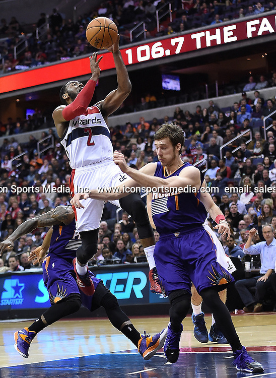 March 26, 2014 - Washington, DC, USA - Washington Wizards guard John Wall (2) drives to the basket against Phoenix Suns guard Goran Dragic (1) during the second half of their game played at the Verizon Center in Washington, Wednesday, Mar. 26, 2014. Phoenix defeated Washington 99-93