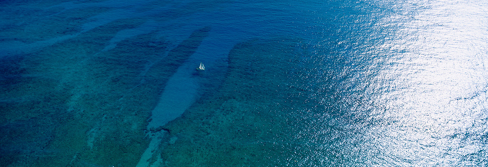 Ocean with sailboat, Hawaii