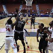 Michael Carrera, South Carolina, drives to the basket  during the St. John's vs South Carolina Men's College Basketball game in the Hall of Fame Shootout Tournament at Mohegan Sun Arena, Uncasville, Connecticut, USA. 22nd December 2015. Photo Tim Clayton