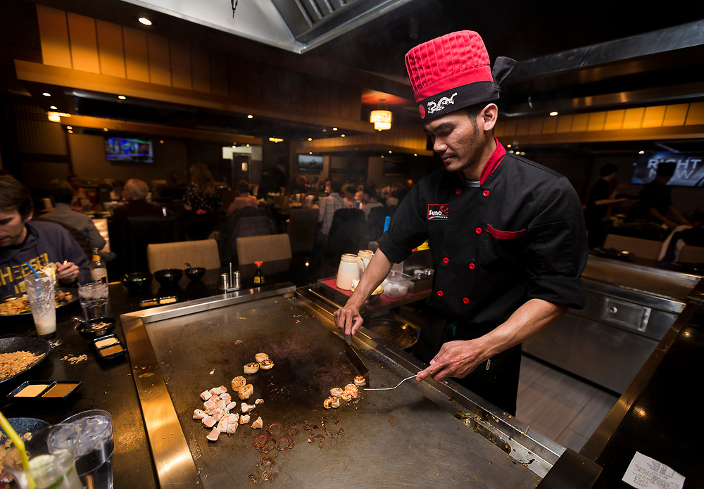 Hibachi chef Isma performs culinary tricks during dinner at Sumo Japanese Steakhouse & Sushi Bar in Madison, Wisconsin, Wednesday, March 21, 2018.