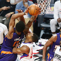 31 October 2016: Phoenix Suns forward Marquese Chriss (0) is fouled by Los Angeles Clippers forward Wesley Johnson (33) during the Los Angeles Clippers 116-98 victory over the Phoenix Suns, at the Staples Center, Los Angeles, California, USA.