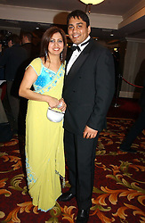 KARL SANDHU CEO of Gold's Gym and his wife SHINDER at the 10th Anniversary Asian Business Awards 2006 at the London Grosvenor Hotel Park Lane, London on 19th April 2006.<br />