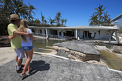 Mike Gilbert and his daughter, Brook Gilbert, 15, stand over the remnants of a three-story, 12-unit condominium near Islamorada, along the Overseas Highway in the Florida Keys, on Tuesday, September 12, 2017. Mike Gilbert was a resident in the building, which collapsed during the storm surge caused by Hurricane Irma. Photo by Al Diaz/Miami Herald/TNS/ABACAPRESS.COM