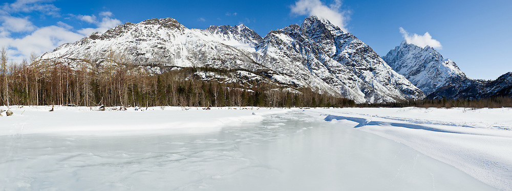 Composite panorama of the Chugach Mountains and Eagle River Valley in Chugach State Park in late winter in Southcentral Alaska. Afternoon.