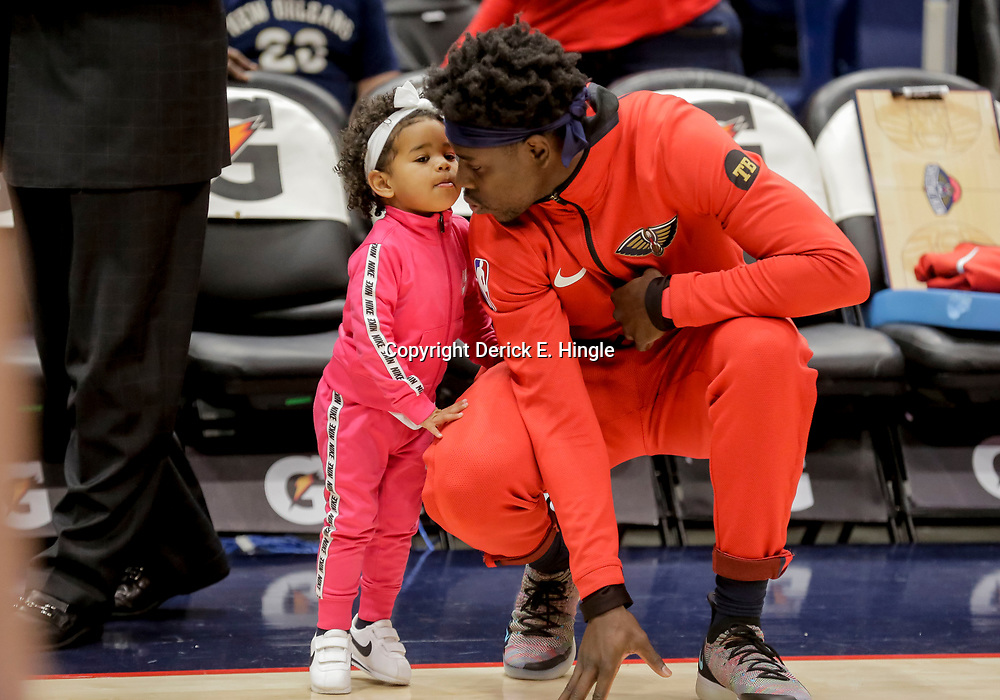Dec 16, 2018; New Orleans, LA, USA; New Orleans Pelicans guard Jrue Holiday kisses his daughter Jrue Tyler Holiday before tip off against the Miami Heat at the Smoothie King Center. Mandatory Credit: Derick E. Hingle-USA TODAY Sports