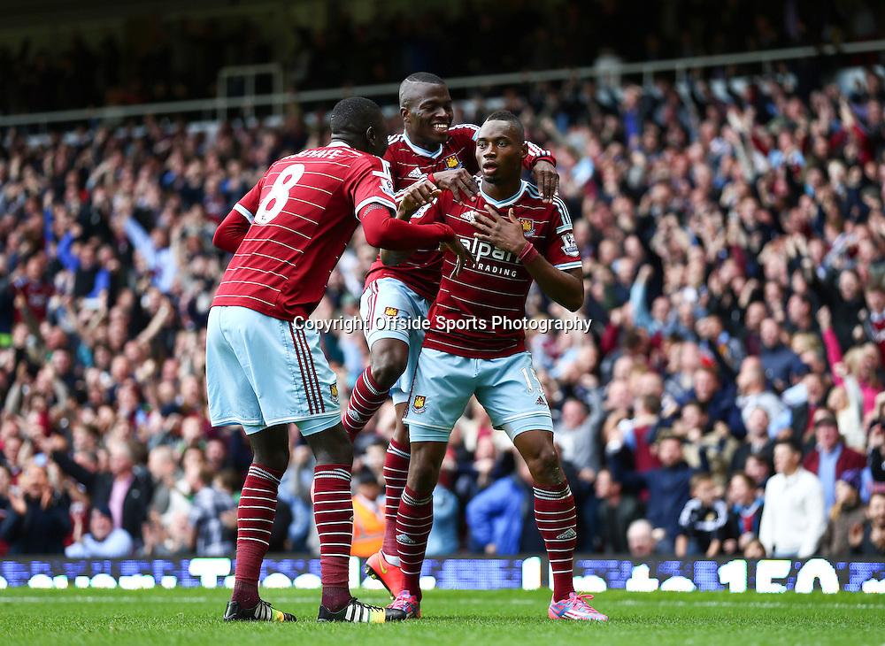 25 October 2014 - Barclays Premier League - West Ham v Manchester City - Diafra Sakho of West Ham celebrates scoring the winning goal with team mates - Photo: Marc Atkins / Offside.