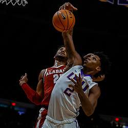 Jan 13, 2018; Baton Rouge, LA, USA; LSU Tigers guard Brandon Rachal (2) rebounds over Alabama Crimson Tide forward Braxton Key (25) during the first half at the Pete Maravich Assembly Center. Mandatory Credit: Derick E. Hingle-USA TODAY Sports
