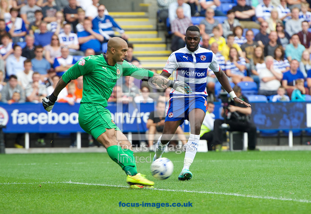 Goalkeeper Carl Ikeme of Wolverhampton Wanderers is put under pressure by Hope Akpan of Reading during the Sky Bet Championship match at the Madejski Stadium, Reading<br /> Picture by Alan Stanford/Focus Images Ltd +44 7915 056117<br /> 28/09/2014
