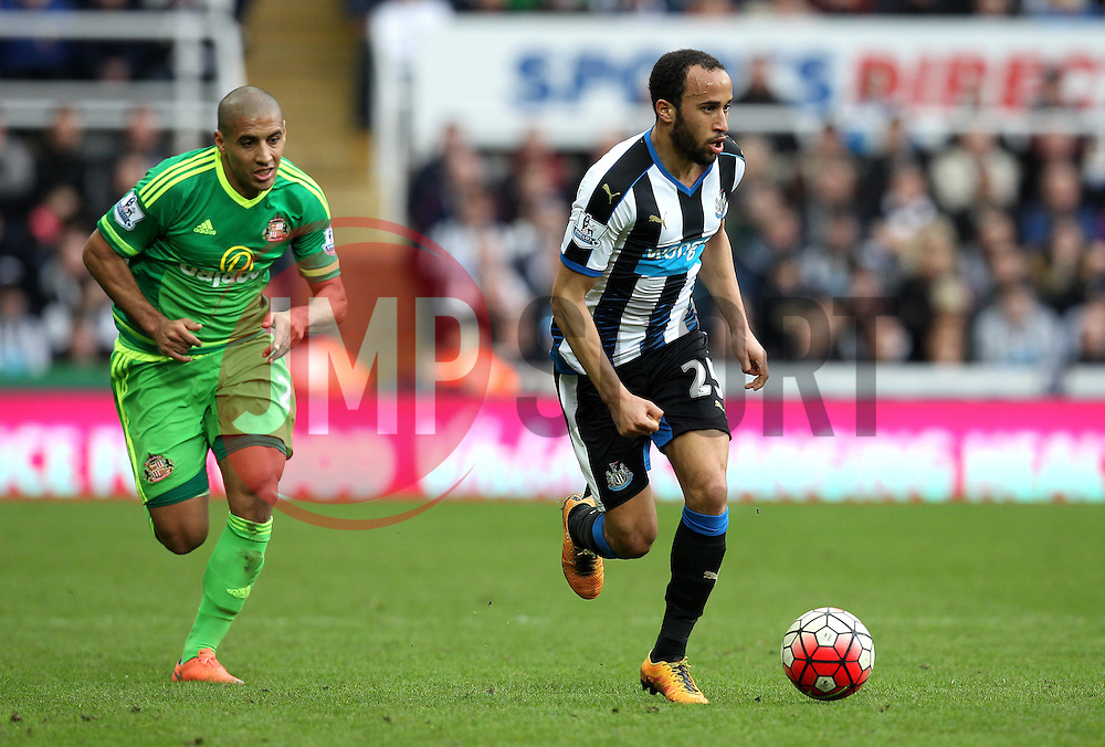 Andros Townsend of Newcastle United runs with the ball away from Wahbi Khazri of Sunderland - Mandatory byline: Robbie Stephenson/JMP - 20/03/2016 - FOOTBALL - ST James Park - Newcastle, England - Newcastle United v Sunderland - Barclays Premier League