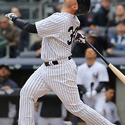 Brian McCann, New York Yankees, batting during the New York Yankees V Baltimore Orioles home opening day at Yankee Stadium, The Bronx, New York. 7th April 2014. Photo Tim Clayton