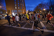Runners from the South End Athletic Company take part in a memorial run for the victim's of Monday's terrorist bombings near the finish line of the Boston Marathon, in Boston, MA on Tuesday, April 16, 2013.  (Matthew Cavanaugh for The Washington Post)