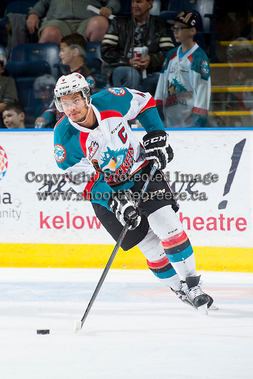KELOWNA, CANADA - MAY 13: Madison Bowey #4 of Kelowna Rockets skates with the puck against the Portland Winterhawks on May 13, 2015 during game 4 of the WHL final series at Prospera Place in Kelowna, British Columbia, Canada.  (Photo by Marissa Baecker/Shoot the Breeze)  *** Local Caption *** Madison Bowey;