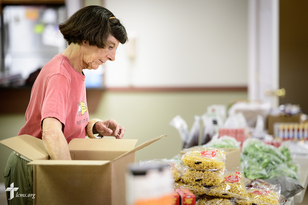 Donna Lee Johnson serves as a volunteer in the Broadmoor Food Pantry adjacent to Gloria Dei Lutheran Church on Wednesday, March 9, 2016, in New Orleans. Johnson, who is homeless in the community, came to the church four years ago and volunteers in the pantry and attends worship. LCMS Communications/Erik M. Lunsford