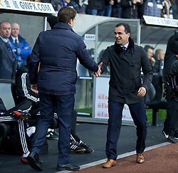 SWANSEA, WALES - Sunday, December 22, 2013: Everton's manager Roberto Martinez greets Swansea City's manager Brian Laudrup before the Premiership match at the Liberty Stadium. (Pic by David Rawcliffe/Propaganda)