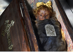 NO WEB FOR FRANCE - The Capuchin Catacombs of Palermo , Sicily, Italy. January 2019. One of the last to be buried there before it closed in 1920 was Rosalia Lombardo, the child whose body has remained remarkably intact due to a process only recently discovered.<br /> The catacombs contain about 8000 corpses and 1252 mummies. Palermo's Capuchin monastery outgrew its original cemetery in the 16th century and monks began to excavate crypts below it. In 1599 they mummified one of their number, recently dead brother Silvestro of Gubbio, and placed him into the catacombs. The cemetery was first reserved for ecclesiastical workers, then accepted deceased from all walks of life, and experienced its greatest popularity during the 19th century. An inscription hanging from the neck or pinned to the chest, indicates the name, birth and death dates of the deceased.The cemetary was officially closed by civil order in 1880. But the last burials are from the 1920s. The cemetary has now become a kind of museum, filled with the forgotten dead, who are watched over by a group of Capuchin monks. Sicily will reveal over time a real research laboratory on mummification. It is spreading throughout the island and there is not an important village in sight that does not display the bodies of their priests, monks or citizens in the crypt of their church. Photo by Eric Vandeville/ABACAPRESS.COM