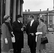 04/07/1963<br /> 07/04/1963<br /> 04 July 1963<br /> Degree day at Trinity College Dublin. The Rev. Chancellor R.J. Williamson and Mrs Williamson, The Rectory, Clones, congratulating their son John Robert Williamson on the conferring of the degrees BA, MB, BCh. and BAO at TCD. Dr Elizabeth Williamson, sister of John, a native of Mallow, Co. Cork, is on the right.