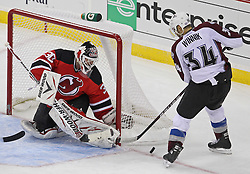 Oct 15; Newark, NJ, USA; New Jersey Devils goalie Martin Brodeur (30) makes a save against Colorado Avalanche left wing Daniel Winnik (34) during the third period at the Prudential Center. The Avalanche defeated the Devils 3-2.