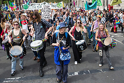 London, UK. 23rd April 2019. The XR Samba Band marches in front of fellow climate change activists from Extinction Rebellion in Parliament Square prior to an assembly and the preparation of letters requesting meetings with Members of Parliament.