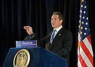 Seaford, New York, USA. 3rd June 2015. New York State Governor ANDREW CUOMO speaks at Press Conference in support of extending the NY Property Tax Cap. At the bi-partisan event at Knights of Columbus Hall, over a hundred area residents and officials urged an extension of the property tax cap before the state legislative session ends on June 17. The NY Property Tax Cap is set to expire June 2016, but is legally linked to NYC rent-control regulations set to expire this month. In June 2011 in Nassau County, the governor signed the first property tax cap law. Podium has The Great Seal of New York and sign with message: Keep the Cap, Property Tax Relief for Families and Businesses.