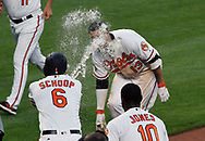 August 23, 2017 - Baltimore, MD, USA - The Baltimore Orioles' Manny Machado, top right, is sprayed with water by teammate Jonathan School (6) after hitting walk-off home run in the 12th inning against the Oakland Athletics at Oriole Park at Camden Yards in Baltimore on Wednesday, Aug. 23, 2017. The Orioles won, 8-7, in 12 innings. (Credit Image: © Kenneth K. Lam/TNS via ZUMA Wire)