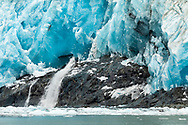 Melt water flows out from Surprise Glacier in Prince William Sound in Southcentral Alaska. Summer. Morning.