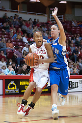 26 February 2006:  Tiffany Hudson takes on Michelle Kaus at the lane.....Illinois State Redbirds out muscled the Creighton Bluejays on Senior day by a score of 75-61.  Senior Holly Hallstorm grabbed her 10th double double with 20 points and 12 rebounds.  Competition took place at Redbird Arena on Illinois State University campus in Normal Illinois.