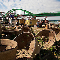 Rusting bits of ships line an industrial area along the Sava River in Belgrade, Serbia.