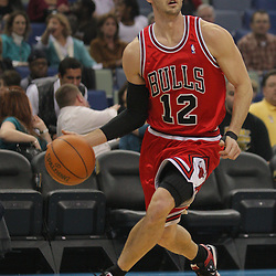 Jan 29, 2010; New Orleans, LA, USA; Chicago Bulls guard Kirk Hinrich (12) drives with the ball against the New Orleans Hornets during the first half at the New Orleans Arena. Mandatory Credit: Derick E. Hingle-US PRESSWIRE