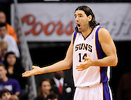 Dec. 09, 2012; Phoenix, AZ, USA; Phoenix Suns forward Luis Scola (14) reacts to a call on the court during the game against the Orlando Magic in the second half at US Airways Center. The Magic defeated the Suns 98-90. Mandatory Credit: Jennifer Stewart-USA TODAY Sports